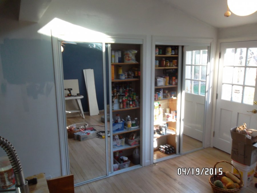 Pair of 4 mirrored sliding doors complete with all hardware still